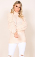 What Now knit in pale pink