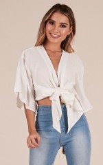 Play The Leader top in white