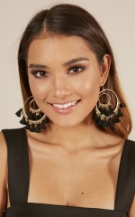 Racing Time earrings in black and gold