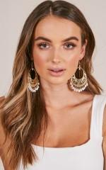 Unheard Of earrings in gold