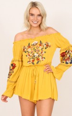 Barcelona playsuit in mustard floral
