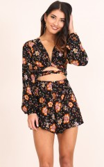 Under The Sun playsuit in black floral