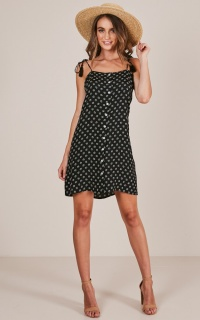 Playful Daisies dress in black floral